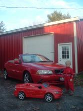My son Grant showing of the Father and Son C70 cars infront of the Volvo Speed Shop