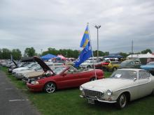 My 1999 Volvo C70 in the Volvo Show Field, Sporting the Swedish and Volvo flags
